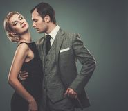 Well-dressed retro style couple. Well-dressed retro couple isolated on grey Stock Photo