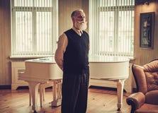 Well-dressed senior man in luxury interior Royalty Free Stock Photos