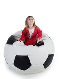 Well-dressed small girl sit on a chair as a ball Royalty Free Stock Images