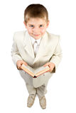 Well-dressed smiling boy hold book Royalty Free Stock Photography