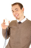 Well-dressed smiling man is holding a card Royalty Free Stock Images