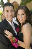 Well-dressed teenage couple embracing outside school dance portrait Stock Image