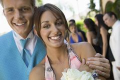 Well-dressed teenage couple at school dance Royalty Free Stock Image