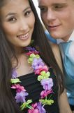 Well-dressed teenage couple wearing leis outside school dance Royalty Free Stock Photography