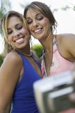 Well-dressed teenage girls taking picture outside school dance low angle view Stock Images