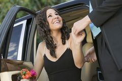 Well-dressed Teenager Girl Being Helped Out Of Limo By Date Stock Image