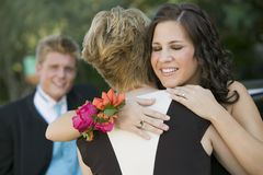 Well-dressed Teenagers Hugging Outside Royalty Free Stock Photos