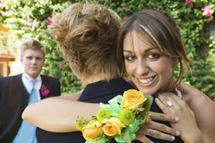 Well-dressed Teenagers Hugging Outside Stock Image