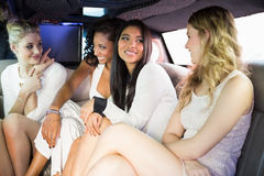 Well dressed women in a limousine Stock Image