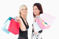 Well-dressed women with shopping bags Stock Images