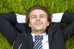 Well-dressed young businessman is resting Royalty Free Stock Photos