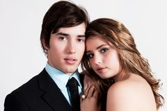 Well Dressed Young Couple Embracing Stock Images