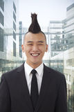Well-dressed young man with Mohawk smiling, portrait, looking at camera Stock Photo