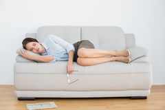 Well dressed young woman sleeping on sofa Stock Image