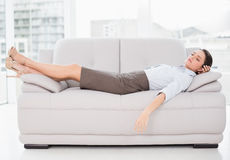 Well dressed young woman sleeping on sofa Royalty Free Stock Photo