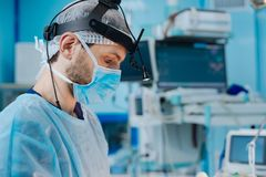 Profile photo of serious doctor that being at work Stock Photos