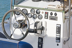 Well equipped dashboard in the pleasure boat. Well equipped dashboard on the pleasure fiberglass boat Stock Image