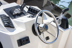 Well equipped dashboard. On white fiberglass boat Stock Photography