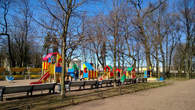 Well equipped Playground in the city center near the Park. Lots of fun for kids and benches for adults. Russia Stock Photography