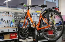 Well-equipped workshop for repairing bicycles. Huge equipped workshop for repairing bikes Royalty Free Stock Image