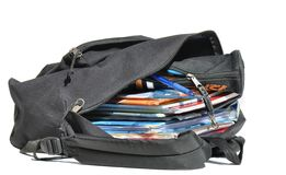 Well-filled schoolbag. Schoolbag open and filled with school matters a bit worn Royalty Free Stock Photo