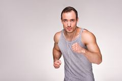Well formed man with running Royalty Free Stock Photography