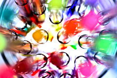 Well Gel. Macro abstract of bright Gel colouring pens in a drinking glass lit from underneath royalty free stock image