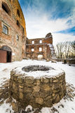 Well in Grodno castle. Grodno castle courtyard in winter - Poland Stock Photography