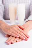 Well-groomed female hands. Well-groomed female hands with the french moon manicure. Advertising of body lotion stock image