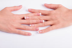 Well-groomed female hands and nails. Royalty Free Stock Photography