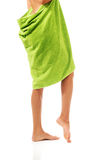 Well groomed female legs wrapped in towel Stock Image
