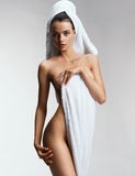 Well-groomed young woman after bath with towel. Stock Images