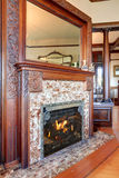 Well kept fireplace with nice decor. Royalty Free Stock Images