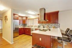 Well kept kitchen with hardwood floor. Royalty Free Stock Image