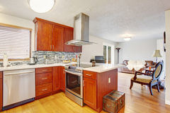 Well kept kitchen with hardwood floor. Royalty Free Stock Photography