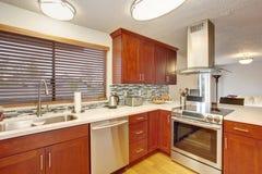 Well kept kitchen with hardwood floor. Stock Photography