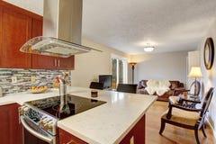 Well kept kitchen with hardwood floor. Stock Photo
