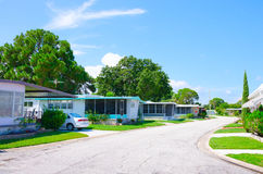 Well Kept Mobile Home Trailer Park in Florida. Street level view of a very well kept mobile home trailer park neighborhood in central Florida with nice yards and stock photo