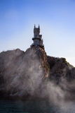 The well-known castle Swallow's Nest in fume near Yalta Stock Image