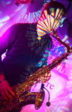 Well-known pop and jazz musician Alexander Mazurov plays a sax solo Stock Photos