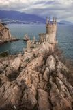 Well-known Swallow`s Nest castle on rock at Black Sea, Crimea, R. Well-known Swallow`s Nest castle on rock at Black Sea in Crimea in Russia stock image