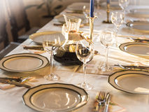 Well-laid Table. A table with wine glasses, dishes and plates for a celebration stock images