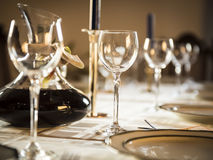 Well-laid Table. A table with wine glasses, dishes and plates for a celebration royalty free stock photos