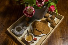 Dutch tulips, walnuts, traditional syrup waffles, sugar pot and Royalty Free Stock Photo