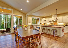 Well lit dinning room with connected living room. Stock Photos