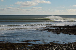 Well lit right breaking wave lining up perfectly at reef break o. N a sunny afternoon in Nova Scotia Canada Stock Photo
