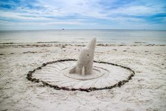 A well made cute and attractive sand dolphin along the shore of Fort Myers, Florida stock image