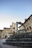 The well. The medieval towers of the Tuscan village stock images
