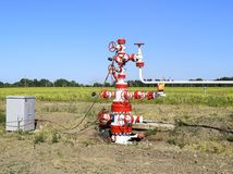 Well for oil and gas production. Oil well wellhead equipment. Oil production Royalty Free Stock Photos