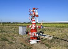 Well for oil and gas production. Oil well wellhead equipment. Oil production.  royalty free stock image